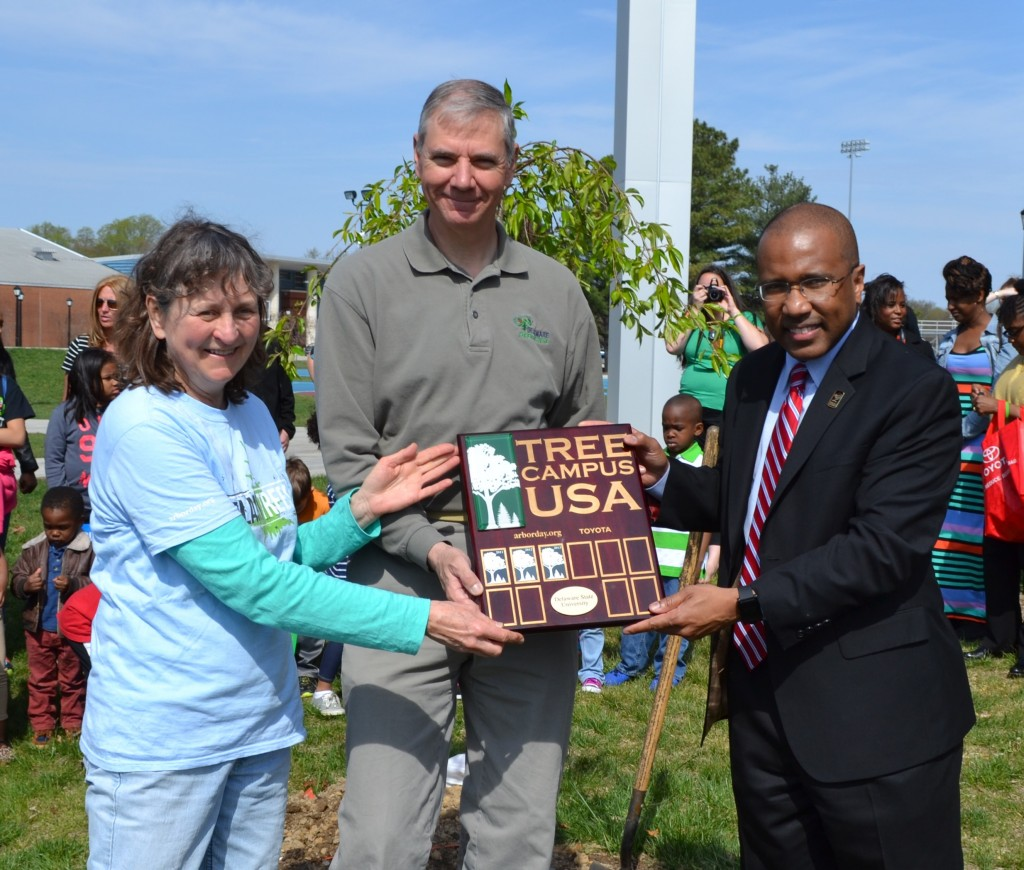From left, Dr. Susan Yost, State Forester Mike Valenti, and Delaware State University President Harry L. Williams celebrate DSU's certification as a Tree Campus USA by the National Arbor Day Foundation. In addition to being the only Tree Campus USA in the First State, DSU is currently the only historically Black college or university (HCBU) to be recognized in the United States.