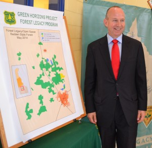 Governor Markell looks at a map showing where 370 acres of foresltna in Sussex County will be added to Redden State Forest.