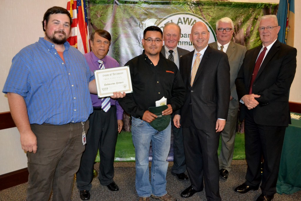 (from left) Michael Krzyzanowski of Delmarva Power receives the Tree Line USA Award joined by Dover Mayor Robin Christiansen, George Vasquez of Asplundh Tree Expert Company, Rep. David L. Wilson, Gov. Jack Markell, Sec. of Agriculture Ed Kee, and Rep. Harvey Kenton.
