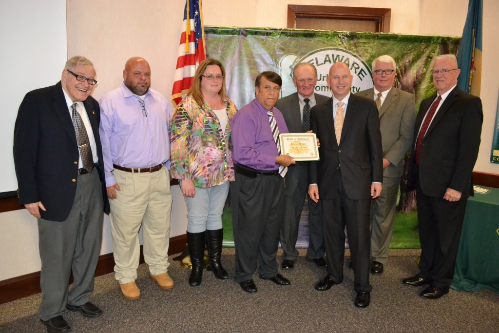 From left, Dover City Councilman Fred Neil, Grounds Supervisor George Jamar, Public Works Director Sharon Duca and Dover Mayor Robin Christiansen accept an award recognizing the City of Dover as a Tree City USA for 27 years, the longest run of any municipality in the First State. Congratulating them are Rep. David L. Wilson, Secretary of Agriculture Ed Kee, Governor Jack Markell, and Rep. Harvey Kenton.