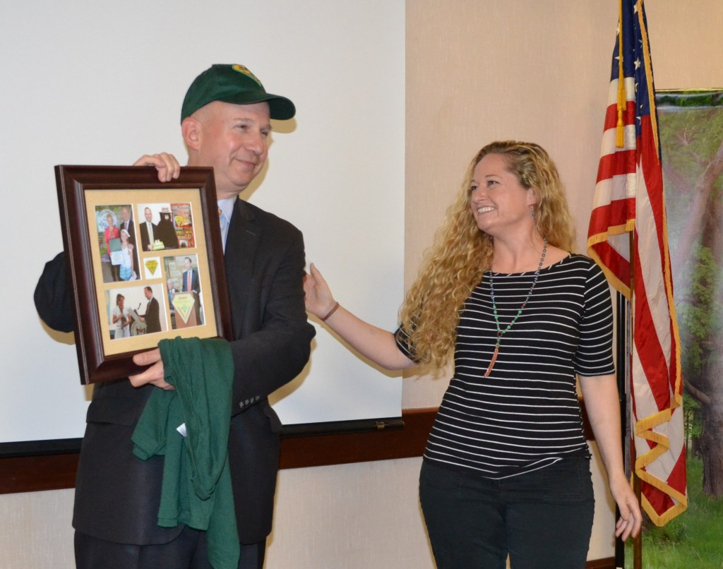Governor Markell receives a commemorative photo frame from Delaware Forest Service education specialist Ashley Peebles.
