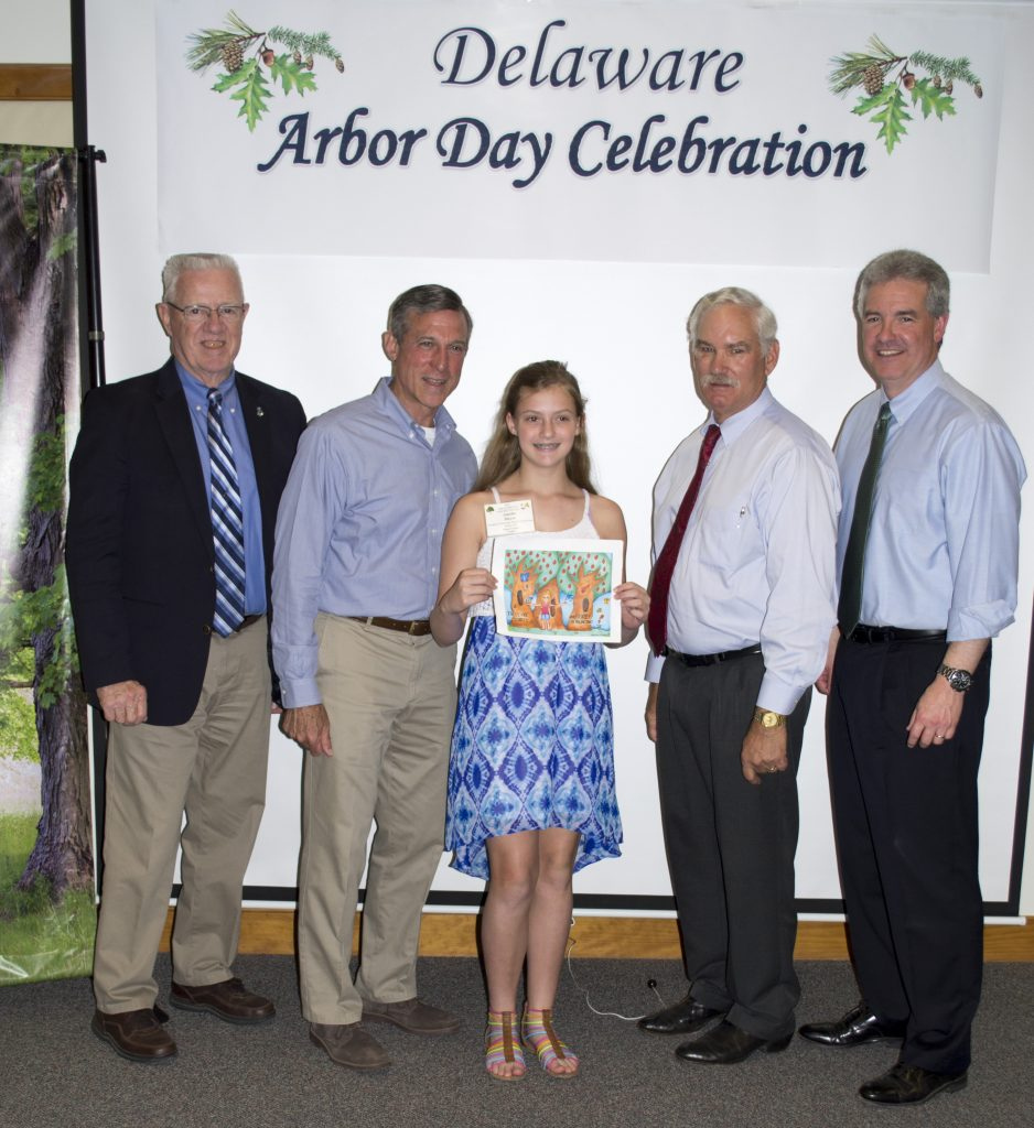 Delaware 2018 Arbor Day poster contest winner Amelia Meyer and Gov. Carney with state officials