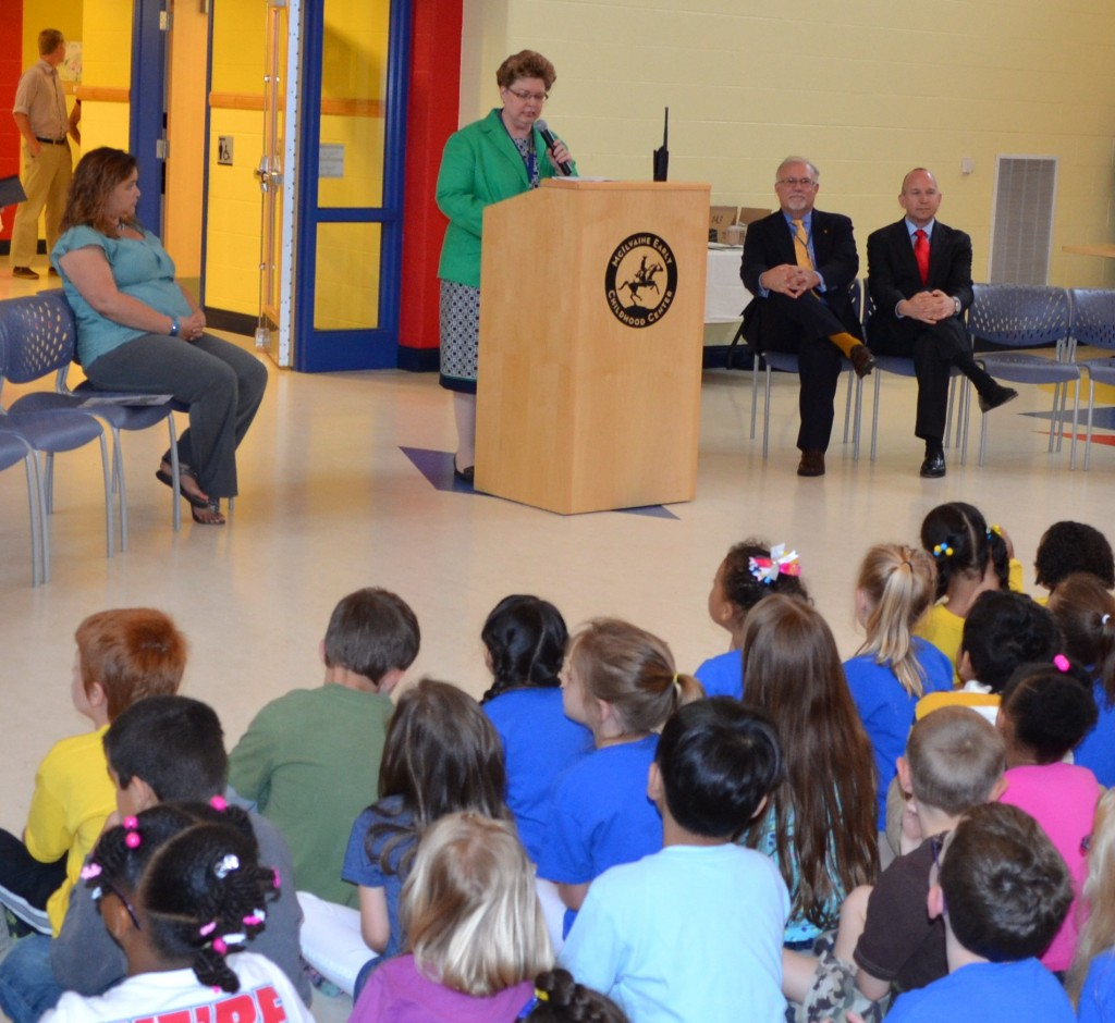 """Dr. Sherry Kijowski, recently honored as Principal of the Year, talks to kindergarten students about McIlvaine's new """"Tree Walk & Talk Arboretum"""" as Asst. Principal Brook Castillo, Gov. Markell and Superintendent Fitzgerald listen."""