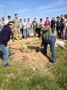 This tree planting project at Penn Farms involved students from nearby schools.