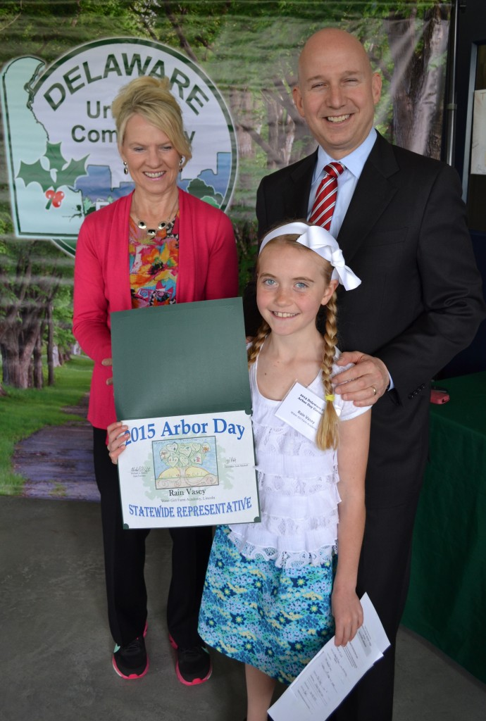 Sen. Bethany Hall-Long (D-10, Middletown) and Governor Markell recognize Rain Vasey of Watergirl Farm Academy in Lincoln as the winner of the Arbor Day Poster Contest.